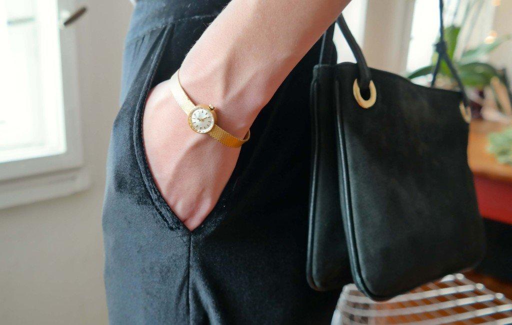 Detailfoto Uhr und Tasche