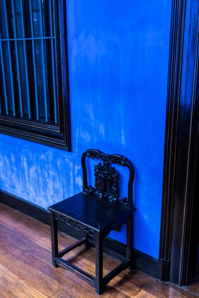 Stuhl im Flur des Cheong Fatt Tze Hauses